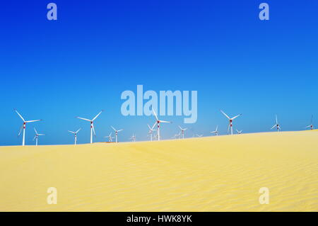Wind turbines at the dunes on a sunny day - Stock Photo