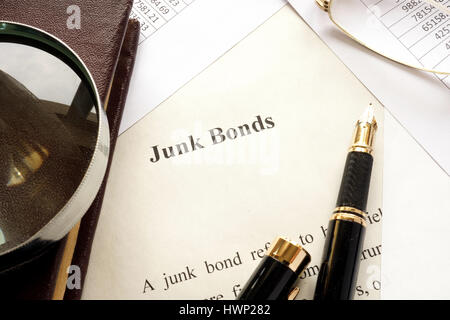 Paper with a title junk bonds and other financial documents. - Stock Photo