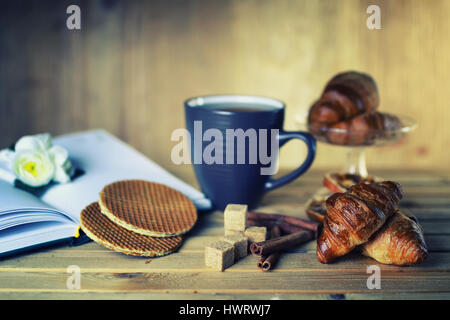 tea cup croissant book - Stock Photo