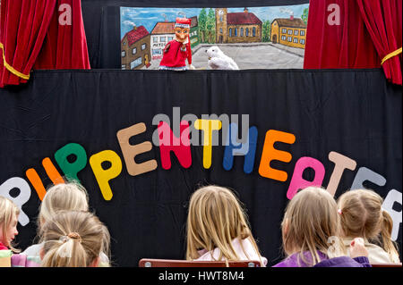 Children watching the puppet theater, Upper Bavaria, Bavaria, Germany - Stock Photo