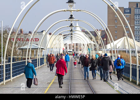 Sunny day in Southport, Merseyside. UK Weather.  23rd March 2017.  People soak up the sunshine taking a stroll on - Stock Photo