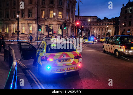 Metropolitan Police vehicle positioned at cordoned off Whitehall in central London following terrorist attack in - Stock Photo