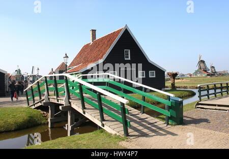 Wooden bridge and traditional house in the village of Zaanse Schans, Zaandam / Zaandijk, Netherlands - Stock Photo
