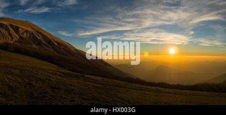 Italy, Marche, Monte Catria in winter at sunset - Stock Photo