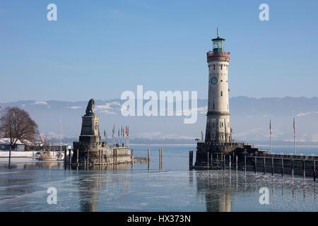 Harbor entrance in winter, Bavarian Lion, New Lighthouse, Lindau, Lake Constance, Bavaria, Germany - Stock Photo