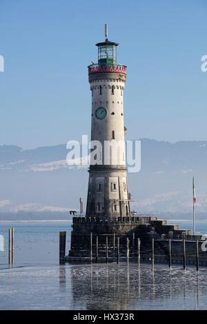 Harbor entrance in winter, New Lighthouse, Lindau, Lake Constance, Bavaria, Germany - Stock Photo