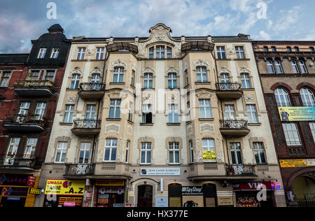 Tenement house on Adam Mickiewicz Street in downtown of Katowice city, the center of the Silesian Metropolis in - Stock Photo