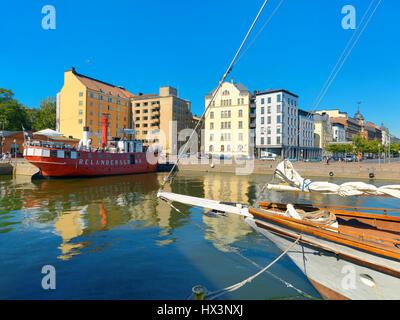 Apartment buildings and pier with famous restaurant Relandersgrund lightship. Helsinki, Finland, Scandinavia - Stock Photo