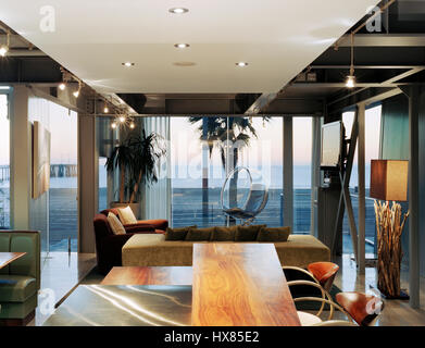Interior view of the living room overlooking the ocean. Panel House, Los Angeles, United States. Architect: David - Stock Photo