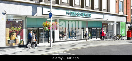 Marks and Spencer M&S shop front windows in Slough Berkshire UK high street retail shopping centre shoppers walking - Stock Photo