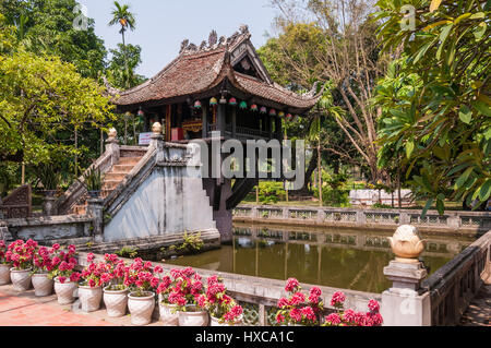 One Pillar Pagoda exterior and large pond on a sunny day, Hanoi, Vietnam - Stock Photo