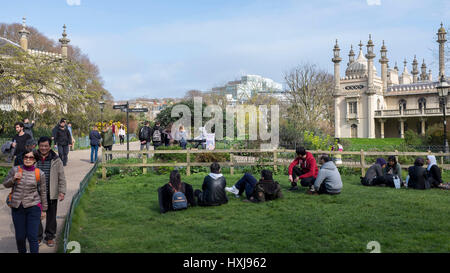 Brighton, UK. 28th Mar, 2017. Visitors enjoy the sunshine in Pavilion Gardens Brighton as the warm Spring weather - Stock Photo