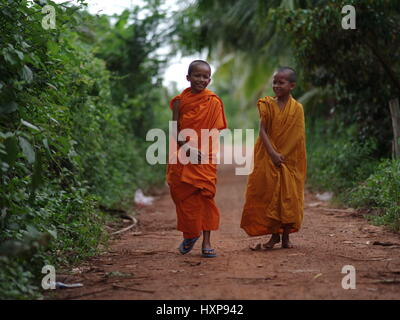 Monks on their way to Pagoda, South Cambodia.  Monks in Cambodia can range from very young boys to old men.  Many - Stock Photo