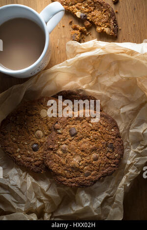 Ariel view of chocolate and nut cookies with a cup of tea - Stock Photo