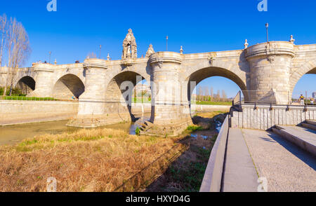The Toledo bridge is a historic construction in Madrid, Spain, built in 1718, crossing the Manzanares river. - Stock Photo