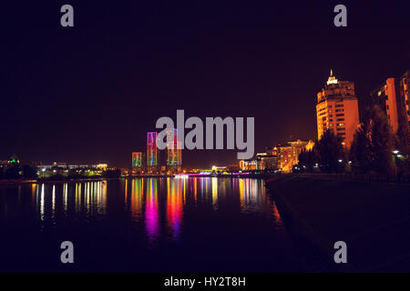 Laser show in the capital of Kazakhstan, Astana. The river Ishim reflects the color light. - Stock Photo