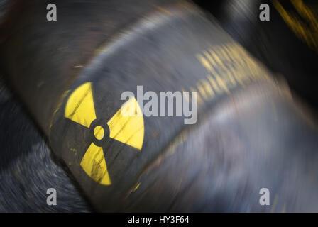 Rusty barrel with radioactivity sign, Rostiges Fass mit Radioaktivitätszeichen - Stock Photo
