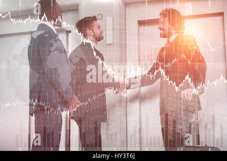 Stocks and shares against businessmen shaking hands while waiting for elevator - Stock Photo