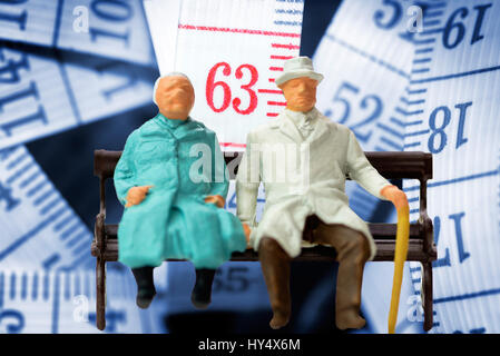 Senior citizen's pair and dimension tape with the number 63, symbolic photo pension with 63, Seniorenpaar und Ma?band - Stock Photo