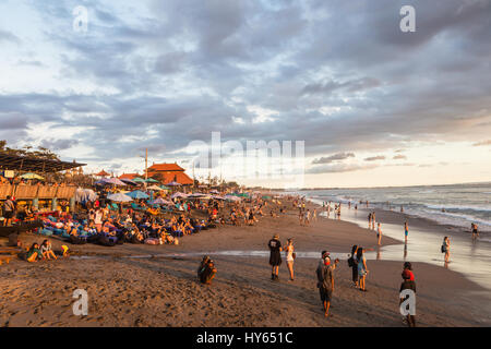 BALI, INDONESIA - FEBRUARY 18, 2017: A crowd of tourists and backpackers enjoy the sunset in a beach bar in Canggu - Stock Photo