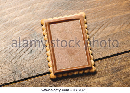 Chocolate covered cookies on wooden background. Isolated. Horizontal shoot. - Stock Photo