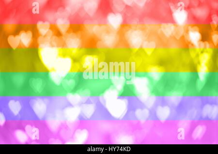 Heart shape bokeh on rainbow flag - Stock Photo