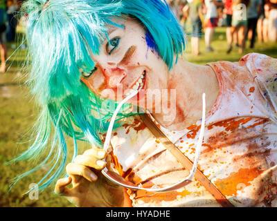 Young girl having fun on holi color festival - Stock Photo