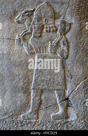 Relief panels orthostat showing a man carrying a gazelle excavated from the Northern Hall at  Sam'al / Zincirli, - Stock Photo