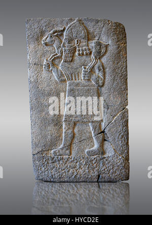 Relief panels orthostat showing a man with a gazelle on the shoulders excavated from the Northern Hall at  Sam'al - Stock Photo
