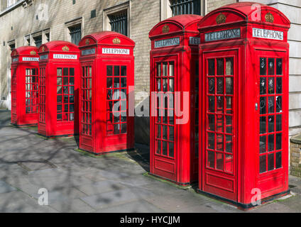 Red Telephone Boxes, England. Row of traditional red phone boxes, Covent Garden, West End, London, England, UK. - Stock Photo
