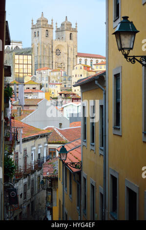 Narrow cobbled street scene in Porto in 2017, Portugal with view to the Se Cathedral Ribeira - Stock Photo