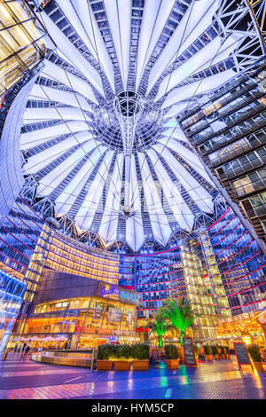 Famous Sony Center at Potsdamer Platz illuminated at night in Berlin, Germany - Stock Photo