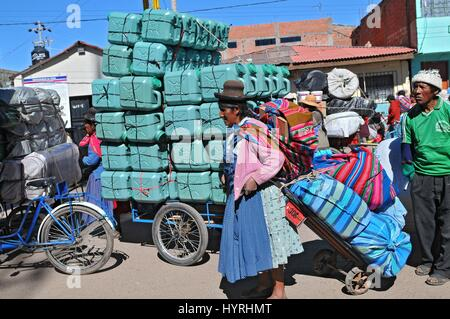 Peru, the border of Bolivia and Peru, Woman Carryng - Stock Photo