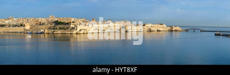 The panoramic view of Valletta capital city over the water of Grand harbor from the Kalkara penincula. Malta - Stock Photo