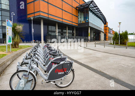 Belfast Bikes hire bikes outside the SSE Arena (formerly the Odyssey Arena), Titanic Quarter, Belfast, County Antrim, - Stock Photo