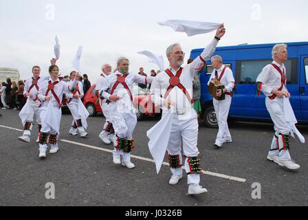 Morris dancers perform during the parade on the West Hill during the annual Jack In The Green festival at Hastings - Stock Photo