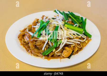 Thai Fried Noodles Pad Thai and vegetables close-up on the table - Stock Photo