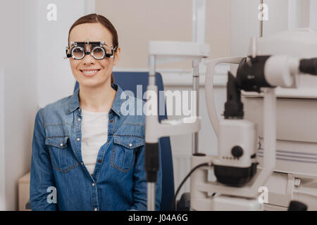 Delighted happy woman wearing eye test glasses - Stock Photo