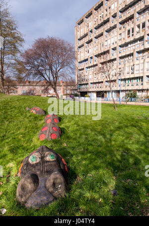London, England, UK - February 17, 2013: A concrete crocodile forms part of a children's play park in the midst - Stock Photo