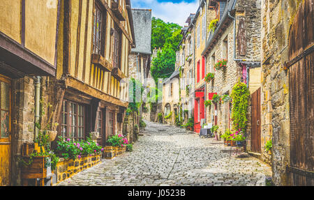 Beautiful view of scenic narrow alley with historic traditional houses and cobbled street in an old town in Europe - Stock Photo