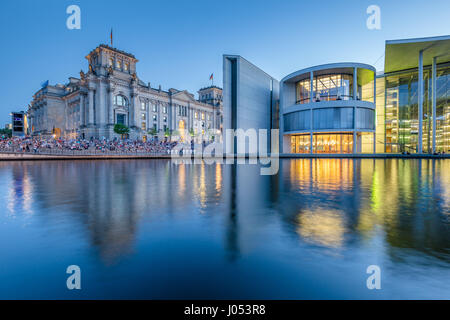 Panoramic view of modern Berlin government district with famous Reichstag building and Spree river illuminated in - Stock Photo