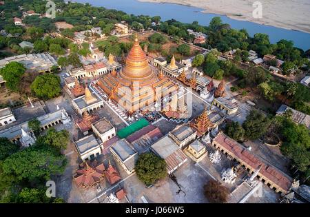 BAGAN, MYANMAR: Shwezigon Pagoda is a Buddhist temple in Nyaung-U, near Bagan. It consists of a circular gold leaf - Stock Photo