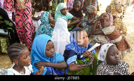 October 2013 – Maradi, Niger / Africa: Muslim school girls under a shadow of a tree, outside of their school. They - Stock Photo