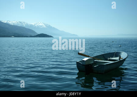 Boat on Ohrid lake, in the southern of the Republic of Macedonia, in an early spring morning  Picture of a boat - Stock Photo