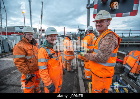 Rail construction workers installing a girder bridge - Stock Photo
