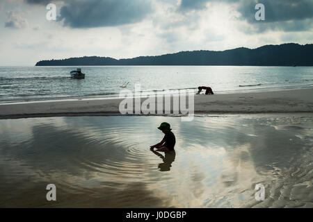 Local kid on the beach of the Koh Rong Sanloem island, Cambodia, Asia. - Stock Photo