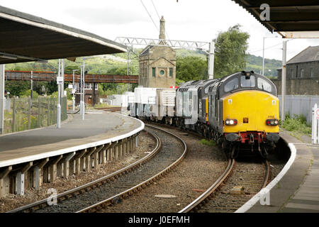 Direct Rail Services Class 37 diesel locomotives hauling nuclear flasks from Sellafield reprocessing plant through - Stock Photo