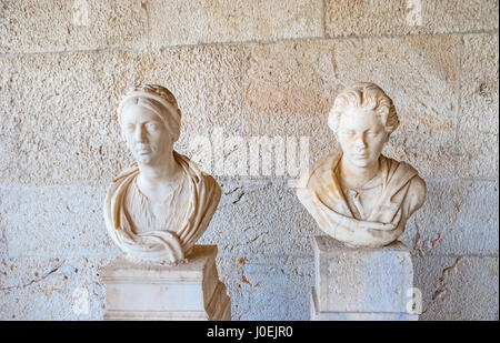 ATHENS, GREECE - OCTOBER 12, 2013: Well preserved marble women busts on Stoa of Attalos museum, on October 12 in - Stock Photo