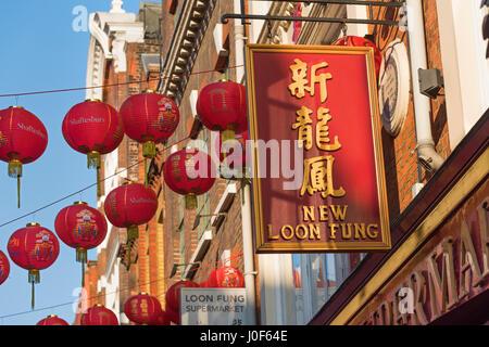 Chinese sign and lanterns Gerrard street Chinatown London UK - Stock Photo