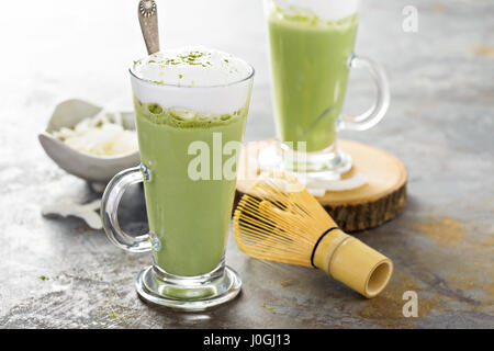 Matcha coconut latte in tall glasses - Stock Photo